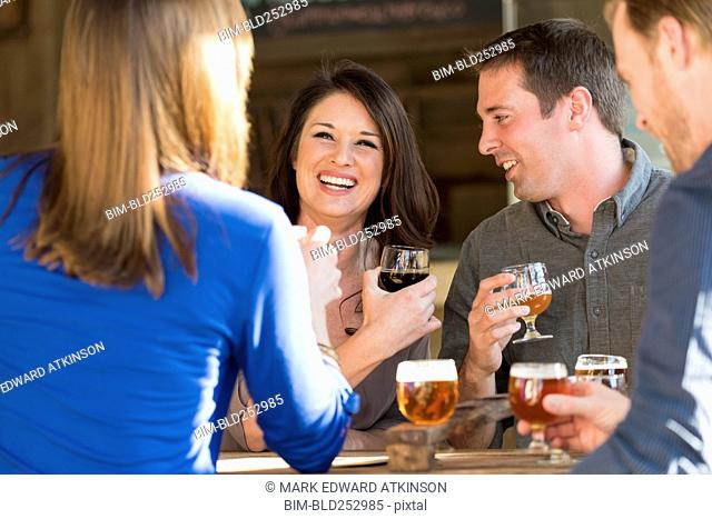 Caucasian friends drinking beer in brew pub