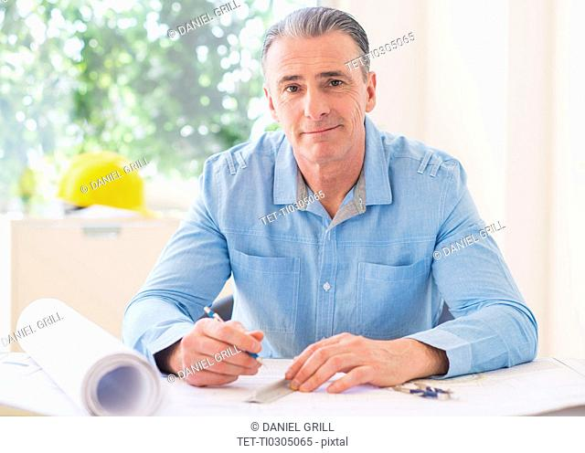 Portrait of man working in office