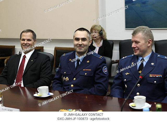 At the headquarters of the Russian Federal Space Agency, Expedition 31 backup crew members Kevin Ford of NASA (left), and Russian cosmonauts Evgeny Tarelkin and...