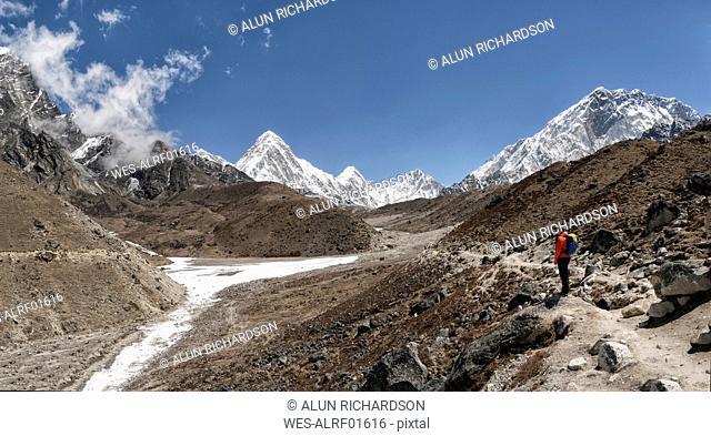 Woman in front of Pumori Mountain, Himalayas, Solo Khumbu, Nepal