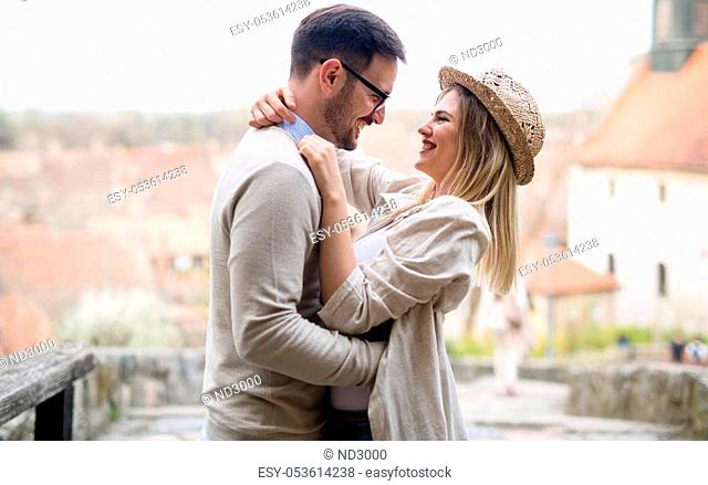 Happy couple in love smiling and dating outdoor