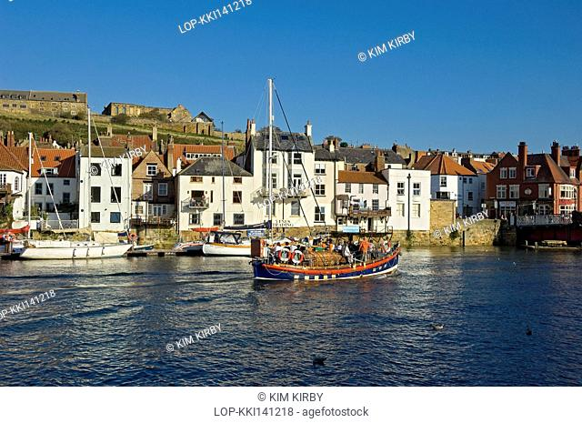 England, North Yorkshire, Whitby. Tourists aboard Whitby's old lifeboat 'Mary Ann Hepworth', now used as a pleasure boat in Whitby Harbour