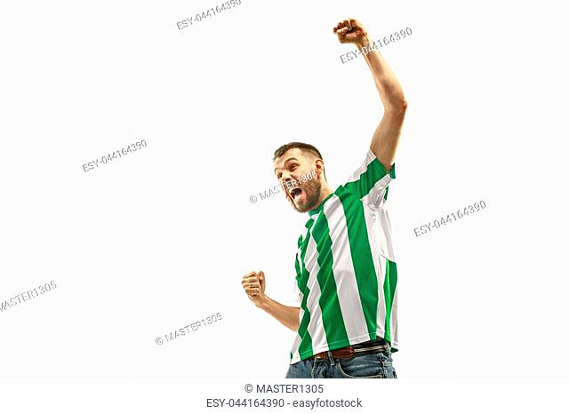 Irish fan celebrating on white background. The young man in soccer football uniform as winner isolated at white studio. Fan, support concept