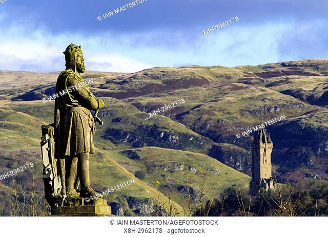 Statue of Robert the Bruce at Stirling Castle and Wallace Monument in distance , Stirlingshire, Scotland, United Kingdom