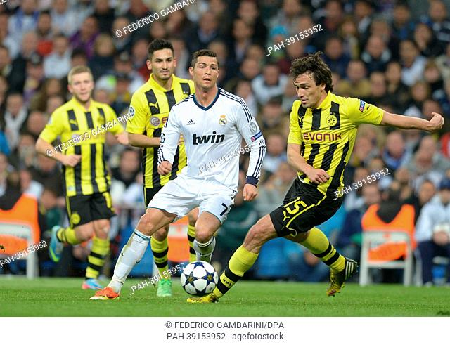 Dortmund's Mats Hummels (R) and Real's Cristiano Ronaldo vie for the ball during the UEFA Champions League semi final second leg soccer match between Borussia...