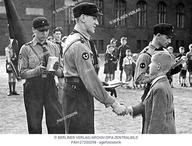 A ten-year-old boy is admitted to the German Youth, the youth organization of the Hitler Youth (DJ) for 10 to 14-year-old boys, on 19 April 1943, in Berlin