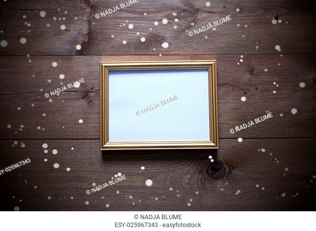 One Golden Picture Frame On Wooden Background. Copy Space For Advertisement. Rutic Vintage Or Retro Style. Snowflakes For Christmas Or Winter Atmosphere