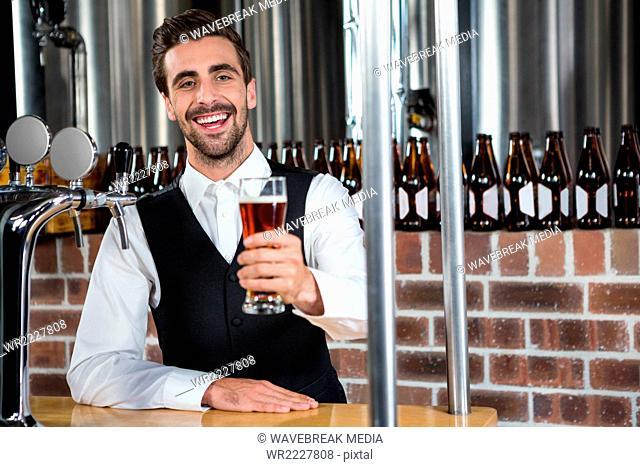 Barman giving a beer