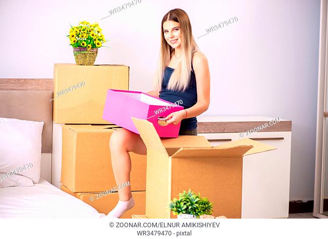Young woman moving to new place