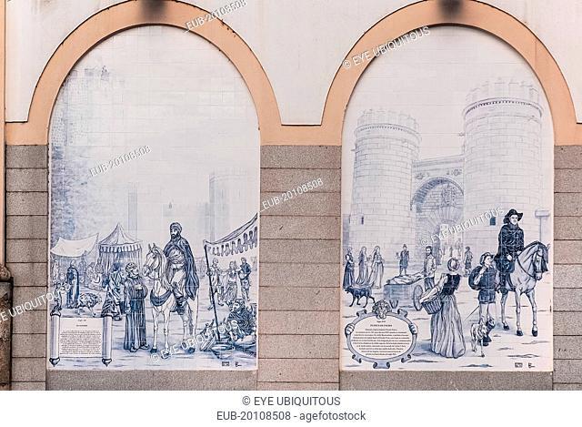 Tiled arches on building in Paseo de San Francisco showing Alcazaba and Puerta de Palmas
