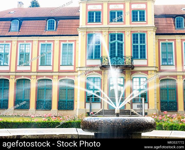 abbots palace landmark in gdansk danzig oliva park poland. famous building with fountain in garden. historical residence house