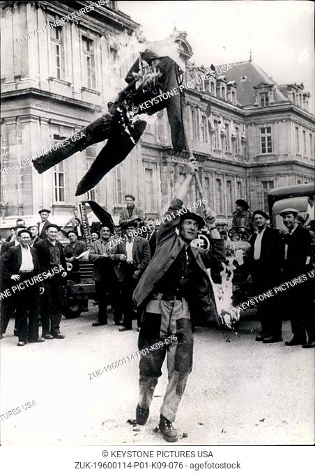 1957 - Demonstrations Go on in the Center of France. The Cultivators Demonstrations go on in France. OPS: A group of Cultivators burning the effigy of Mr