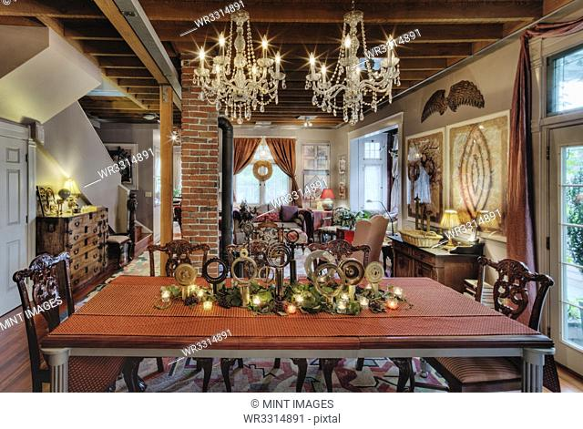 Chandeliers over dining room table