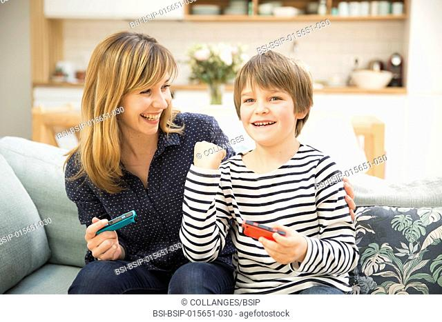 Mother and son playing video game