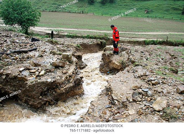 Search and rescue team looking for a lost elderly couple after heavy rains. Asturias, Northern Spain