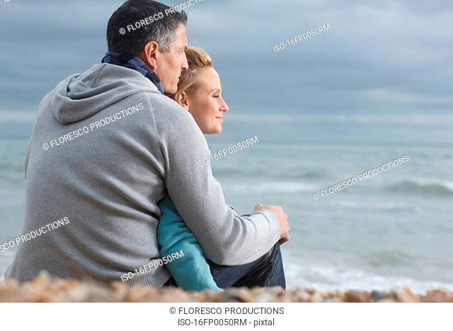 Young Couple looking out to Sea