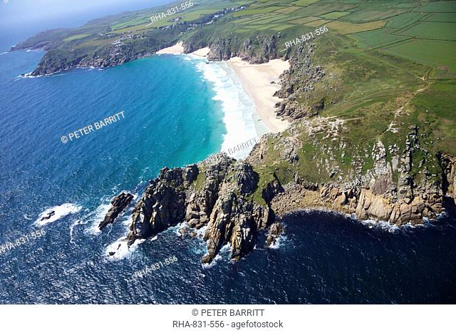 Aerial photo of Treen Cliff and Porthcurno beach looking west to the Minnack Theatre, West Penwith, Cornwall, England, United Kingdom, Europe