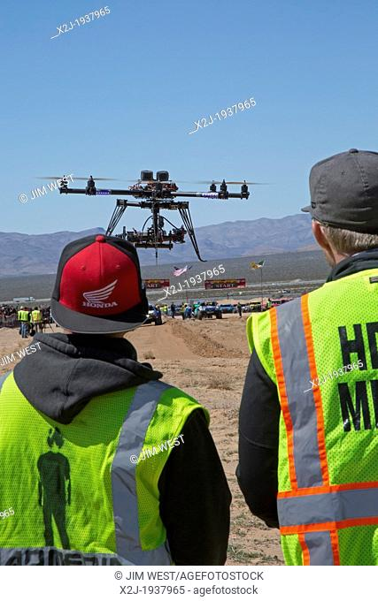 Jean, Nevada - Photographers use an unmanned aerial vehicle to photograph the Mint 400, an off-road race in the Mojave Desert