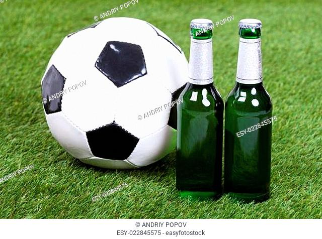 Soccer Ball And Beer Bottles On Green Grass