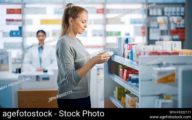 Customer choosing medication in a pharmacy