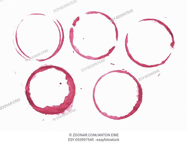 Dry stains of red wine glass or bottle circle rings and blob drops isolated on white background