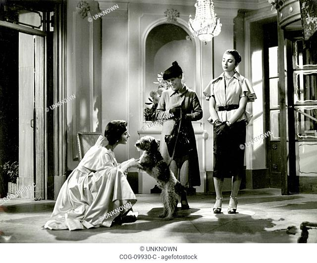 The actresses Yvonne Mitchell, Joan Collins and Katherine Harrison in the movie Turn the Key Softly