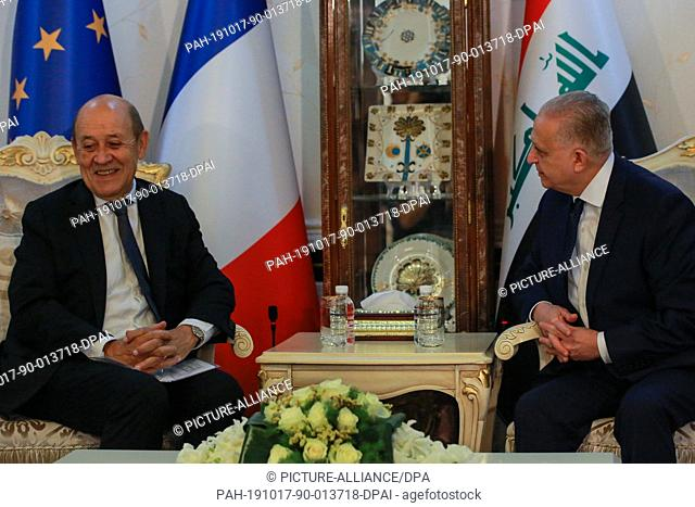 17 October 2019, Iraq, Baghdad: Iraqi Foreign Minister Mohammed Ali al-Hakim (R) meets with his French counterpart Jean-Yves Le Drian