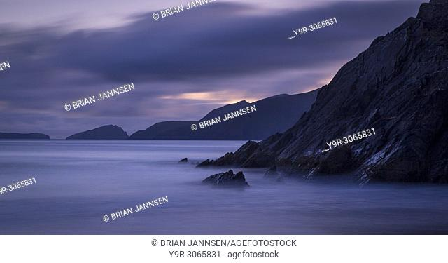Coastline of Dingle Peninsula at Slea Head with Blasket Islands beyond, County Kerry, Republic of Ireland