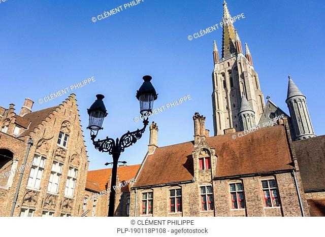 Sint-Janshospitaal / St John's Hospital and church tower of the Church of Our Lady / Onze-Lieve-Vrouwekerk in the city Bruges, West Flanders, Belgium