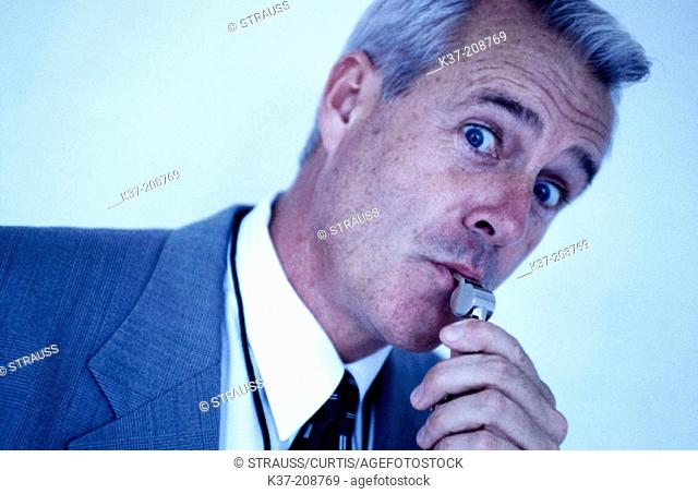 Businessman blowing the whistle on bad deals