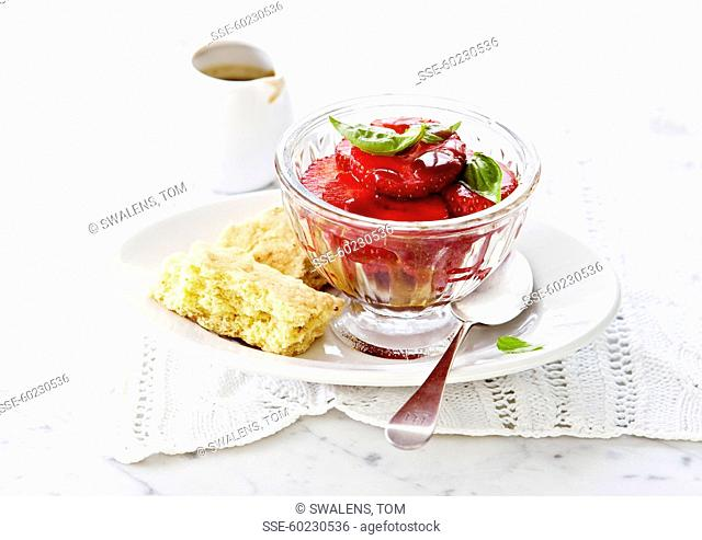 Strawberry fruit salad with basil and crispy biscuits
