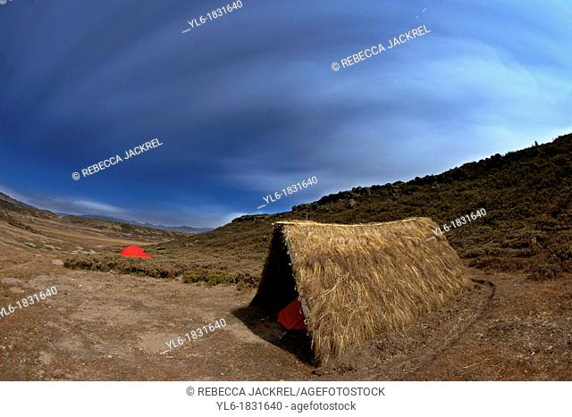 A small grass shelter and tent in the Web Valley, Bale Mountains, Ethiopia