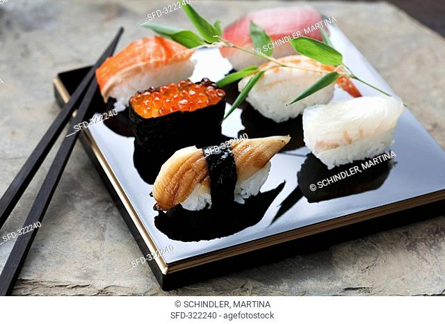 Nigiri sushi with salmon, salmon caviar, tuna, eel, prawn and sea bream