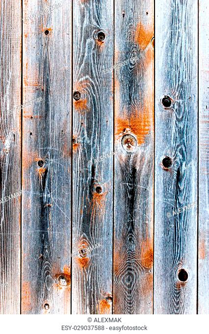 Wooden fence of smoky color with knots