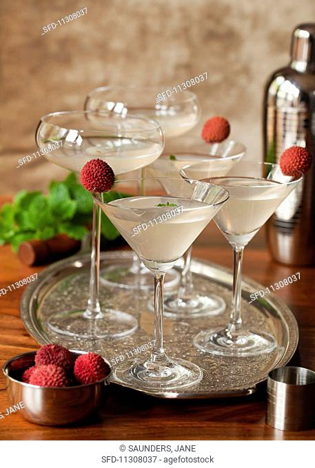 A tray of lychee and mint Martinis garnished with fresh lychees