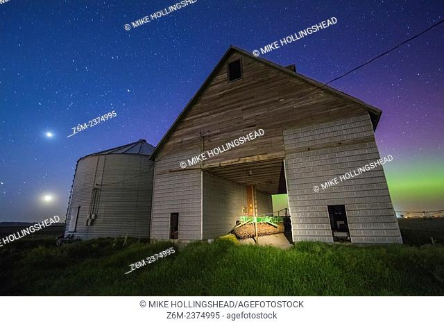 Auroras shine over a barn in western Iowa