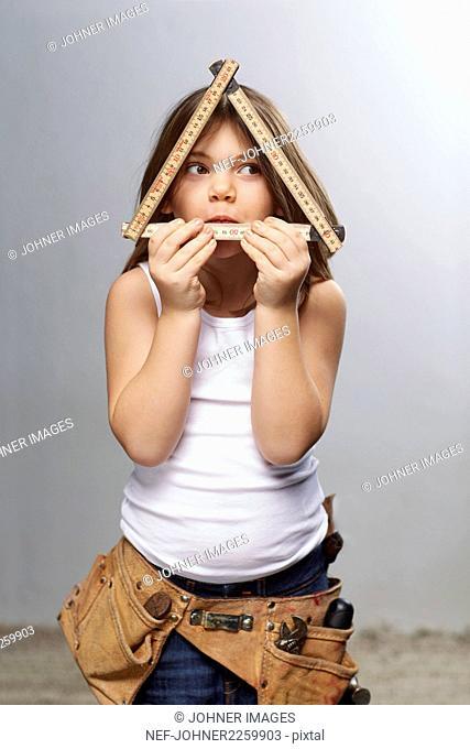 Girl holding ruler