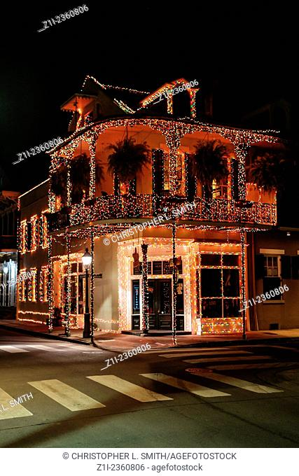 Christmas decorations hang from a shop in the French Qtr of New Orleans at night