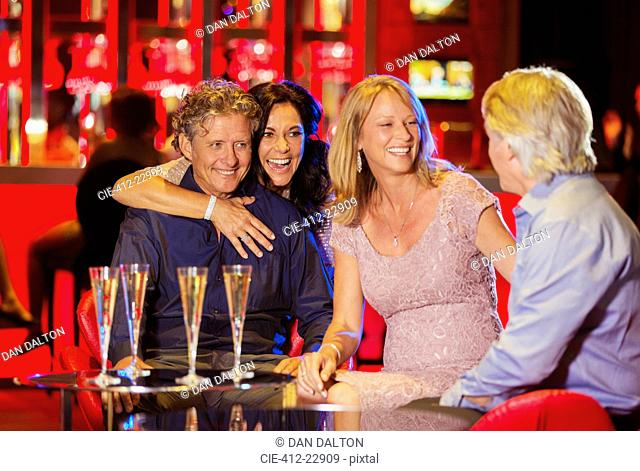 Group of friends having fun in bar