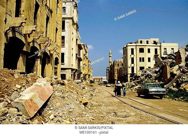 People walking past buildings destroyed by the Lebanese Civil War, Beirut, Lebanon