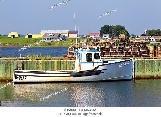 Fishing boats tied up at wharf, Fortune Bay Harbour, Prince Edward Island, Canada
