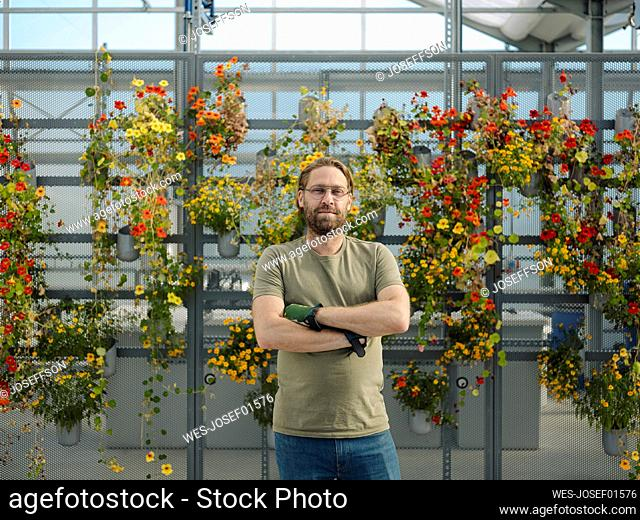 Portrait of a confident man in a greenhouse