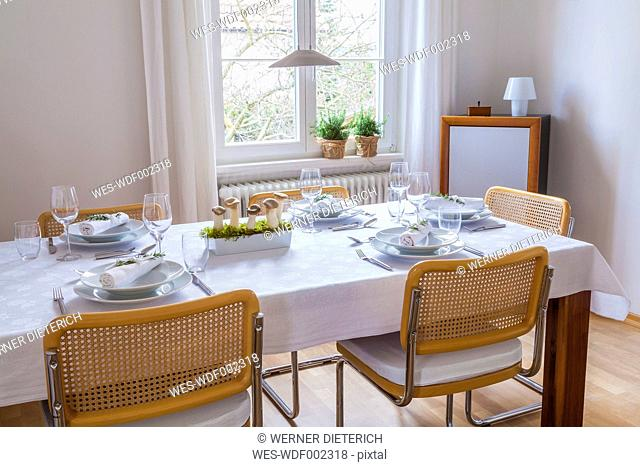 Dining room with festive laid table