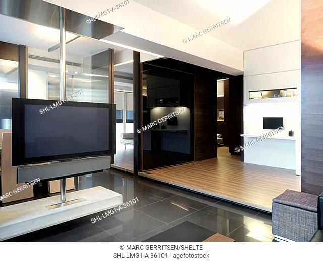 Spacious living area with flat screen television