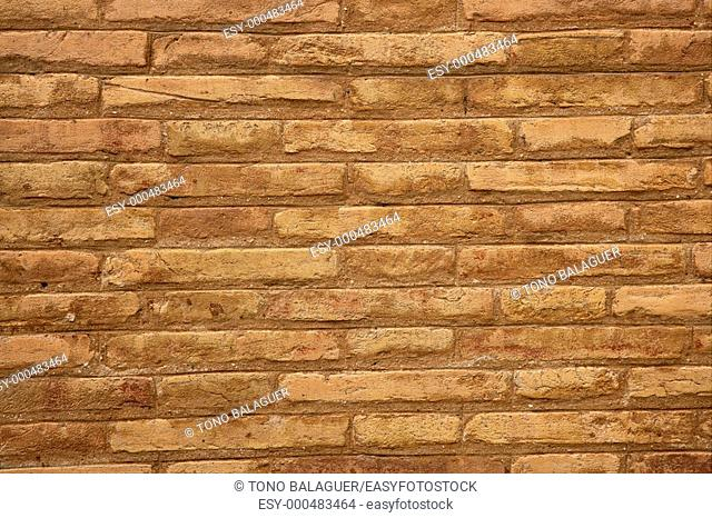 Brown brick wall in cream beige color pattern background