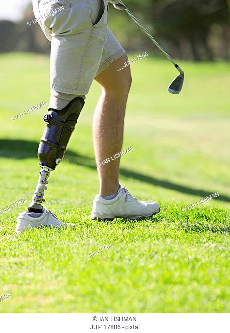 Close Up Of Male Golfer With Artificial Leg Standing By Green