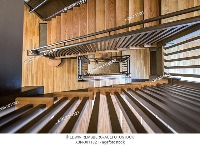 Directly above shot of wooden spiral staircase of building