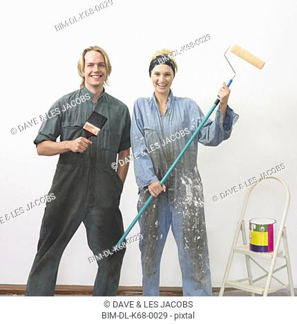 Couple getting ready to paint a wall