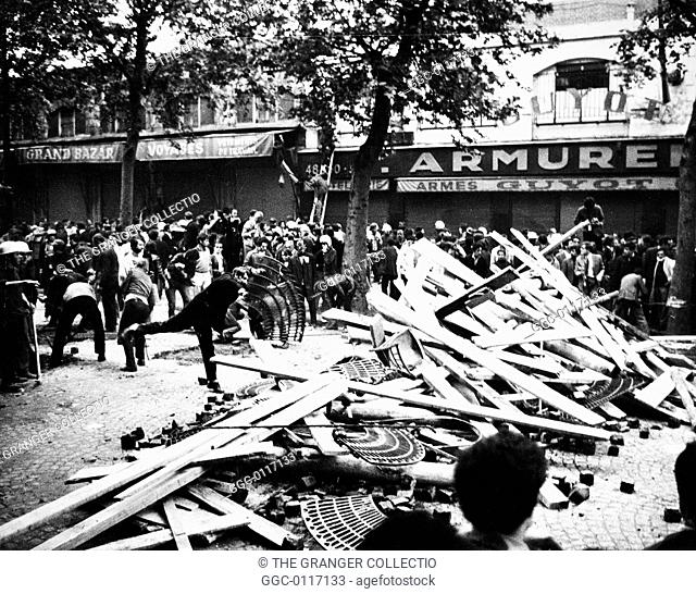 PARIS STUDENT REVOLT, 1968.Students building barricades near Place de la Bastille, Paris, France. Photograph, 24 May 1968