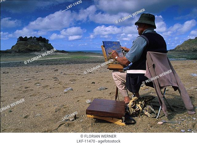 Painter with easel on the beach, Ile de Guesclin, Brittany, France, Europe
